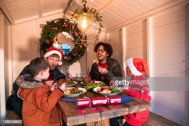 christmas dinner in the christmas cabin - evening meal stock pictures, royalty-free photos & images
