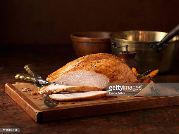 christmas dinner. organic roasted turkey breast on chopping board - turkey meat stock pictures, royalty-free photos & images