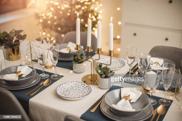 christmas dinner preparation - table stock pictures, royalty-free photos & images