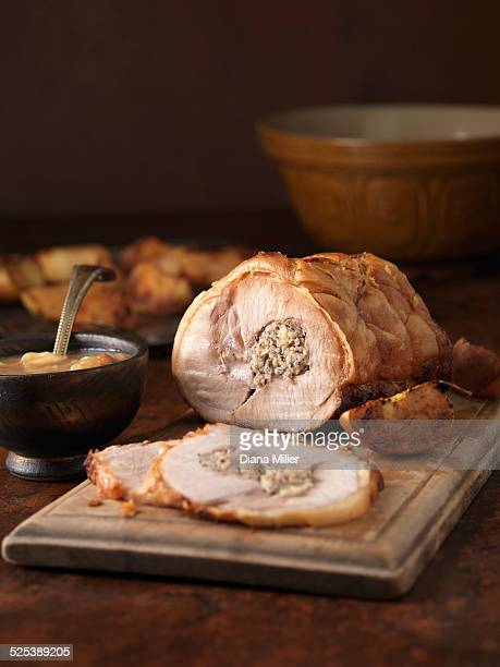 Christmas dinner. Roasted pork loin with pork and apple stuffing and roast potatoes