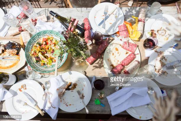 a christmas dinner table after the meal has finished - leftovers stock pictures, royalty-free photos & images