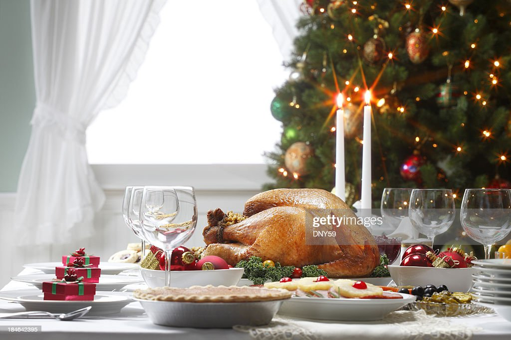 Christmas Dinner Table Spread and Christmas Tree : Stock Photo