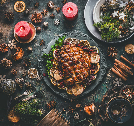 Christmas dinner table with roasted pork ham , flavors, decoration and candles - gettyimageskorea