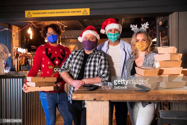 christmas dinner takeout team - restaurant stock pictures, royalty-free photos & images