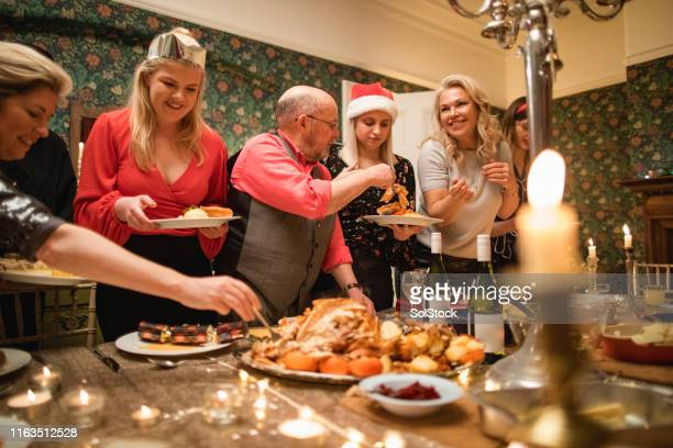 christmas dinner to feed the family - evening meal stock pictures, royalty-free photos & images