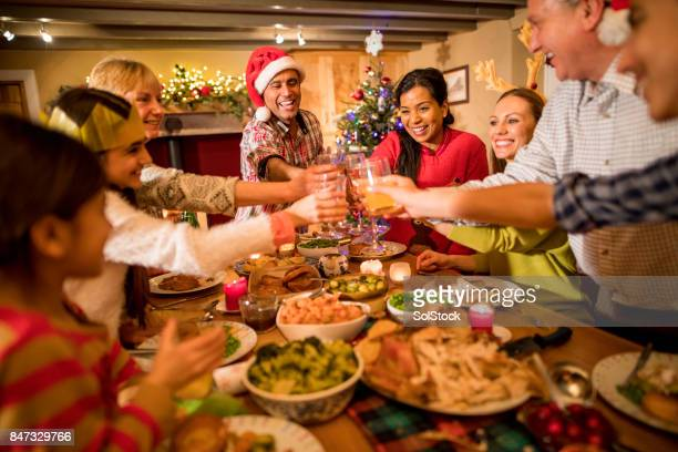 christmas dinner toast - christmas dinner stock photos and pictures