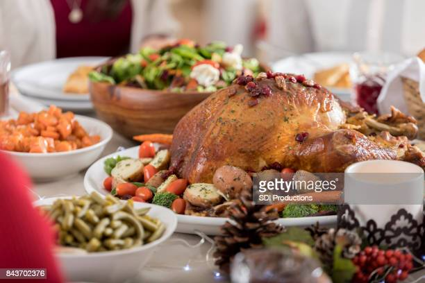 christmas dinner turkey is centerpiece of full table - crab seafood stock photos and pictures
