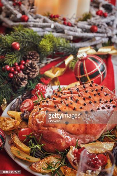 christmas dinner with glazed holiday ham with cloves and vegetables - glazed ham stock pictures, royalty-free photos & images