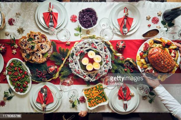 christmas dinner with glazed holiday ham with cloves, vegetables, minced pies and eggnog orange trifle - glazed ham stock pictures, royalty-free photos & images