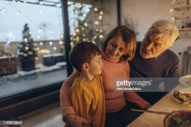 christmas dinner with our grandson - kids thanksgiving stock pictures, royalty-free photos & images