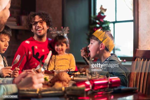 christmas dinner with the family - christmas stock pictures, royalty-free photos & images