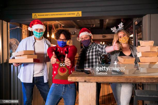 christmas dinners ready for delivery - employee stock pictures, royalty-free photos & images