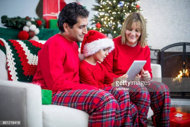 Christmas Diverse Family Using Tablet