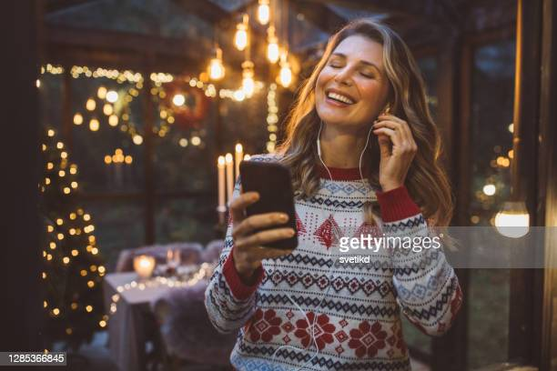 christmas during self-isolation period - christmas music stock pictures, royalty-free photos & images