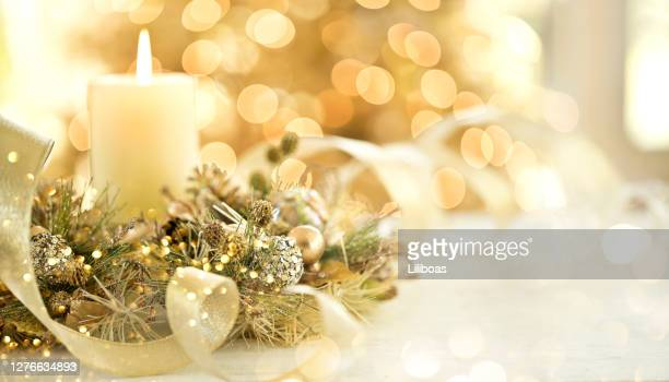 christmas elegant golden candle - christmas decore candle stock pictures, royalty-free photos & images