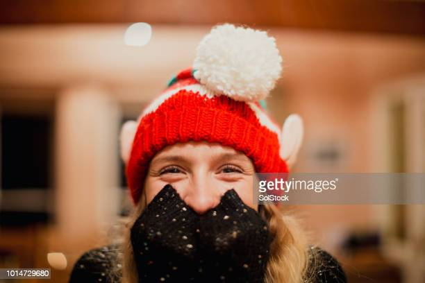 christmas elf at a party - christmas jumper stock photos and pictures