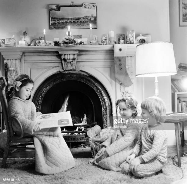 Christmas Eve Children reading bedtime stories as they wait for Santa Newcastle Tyne and Wear Posed picture taken 18th December 1974