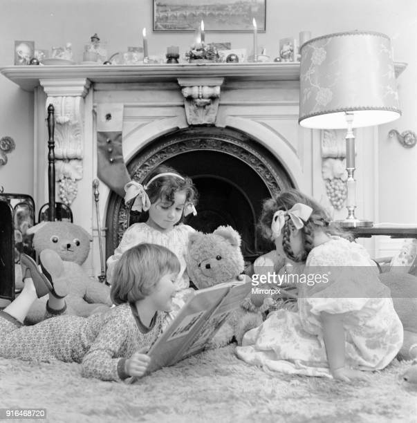 Christmas Eve Children reading bedtime stories as they wait for Santa Newcastle Posed picture taken 18th December 1974