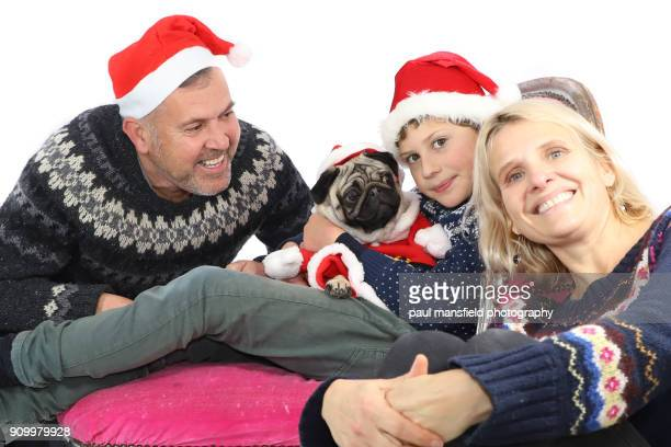 Christmas family portrait with pug