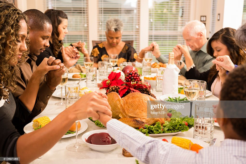 Christmas Family Prays Before Eating Holiday Dinner
