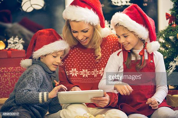Christmas family with digital tablet