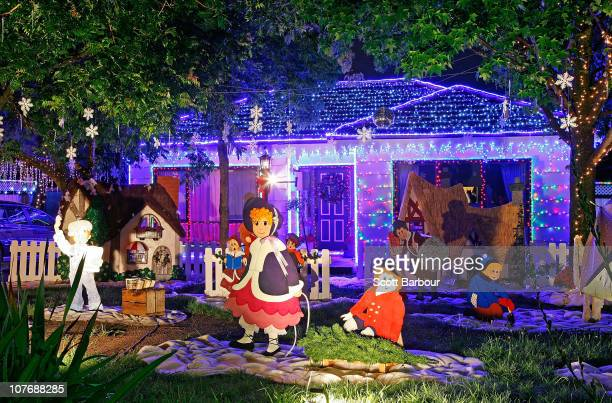 Christmas festive lights are displayed on a house in Macleod on December 19 2010 in Melbourne Australia Residents across Melbourne are lighting their...