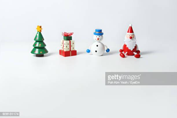 christmas figurine against white background - human representation stock pictures, royalty-free photos & images