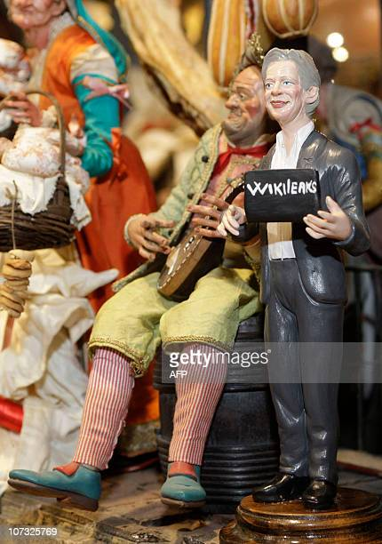 A Christmas figurine made by Italian craftsman Genny Di Virgilio representing WikiLeaks founder Julian Assange holding a laptop is displayed in a...