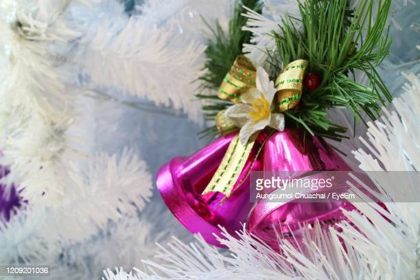 christmas fir tree with decoration, couple pink jingle bell. soft focus. - aungsumol stock pictures, royalty-free photos & images