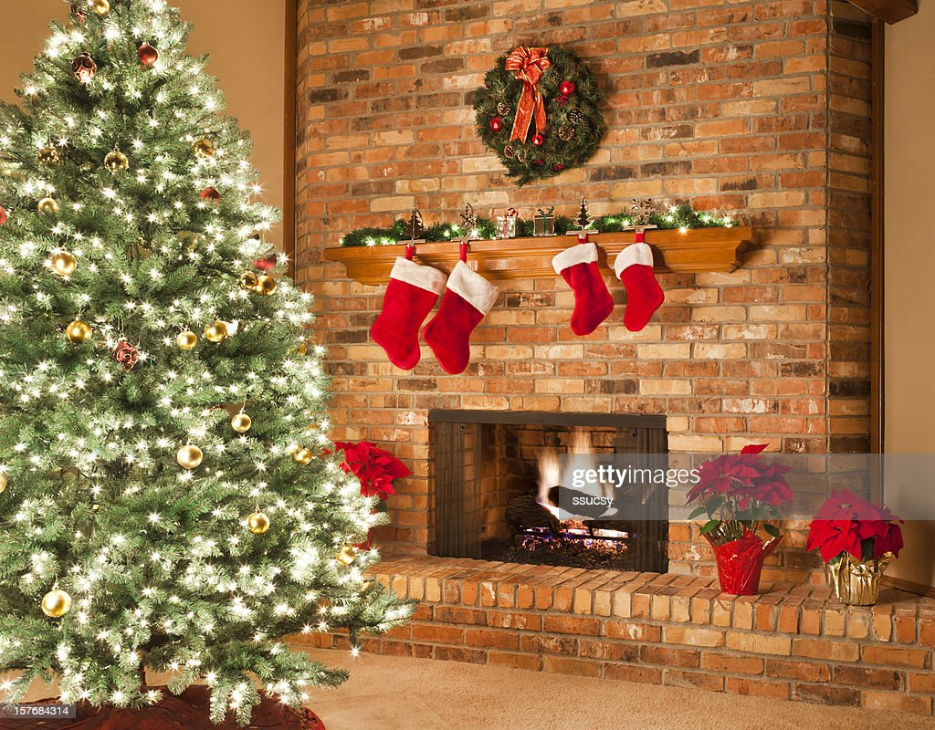 Christmas fireplace fire tree stockings wreath poinsettias for Stocking clips for fireplace