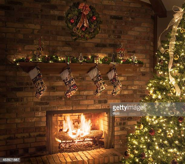 Christmas fireplace, quilted stockings, roaring fire, tree, lights, ornaments