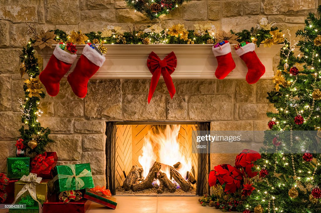 christmas fireplace tree stockings fire hearth lights and decorations