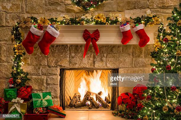 Christmas fireplace, tree, stockings, fire, hearth, lights, and decorations