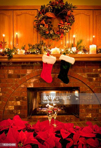 christmas fireside with champagne - christmas stocking stock pictures, royalty-free photos & images