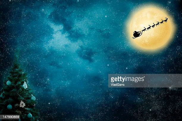 christmas flight - snow moon stock pictures, royalty-free photos & images