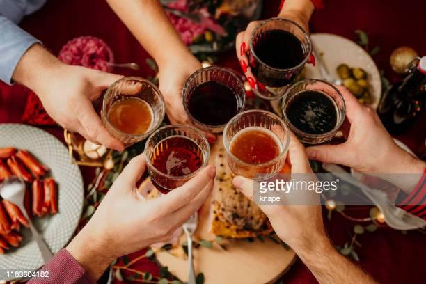 christmas food smörgåsbord people toasting dinner party - food and drink bildbanksfoton och bilder