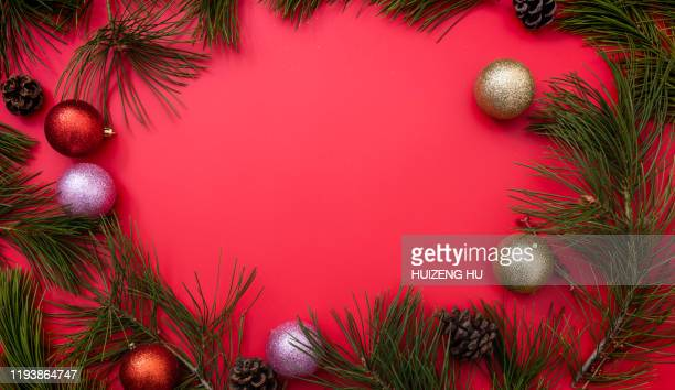 christmas frame, christmas decorations on red background - christmas banner stock photos and pictures