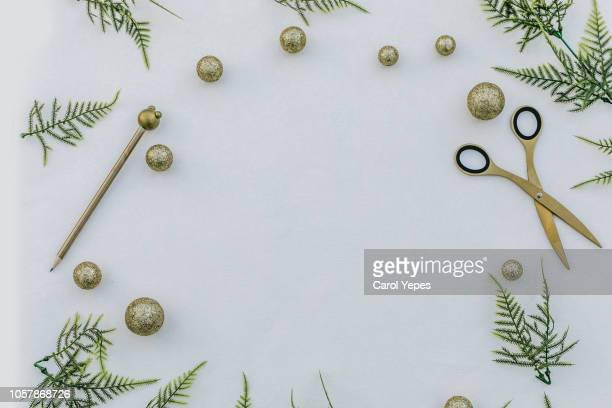 christmas frame with pinecone ,fir branches, scissors,pen - christmas frame stock pictures, royalty-free photos & images