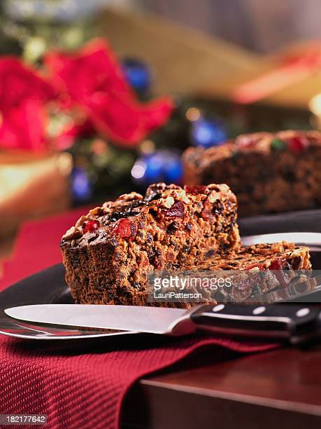 christmas fruit cake cut with knife - fruit cake stock pictures, royalty-free photos & images