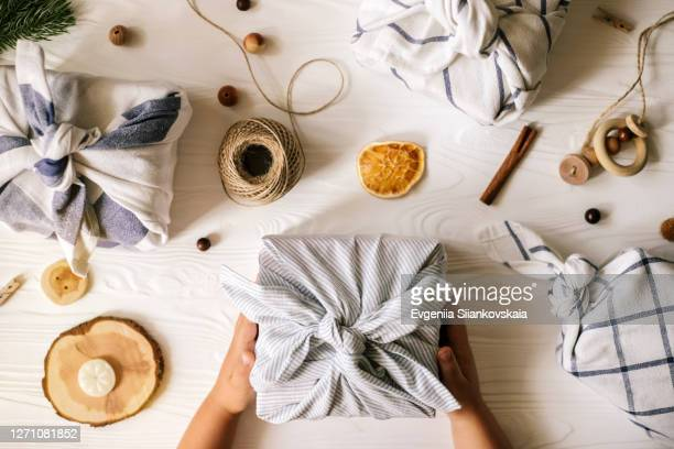 christmas furoshiki wrapping. zero waste concept. - christmas decoration stock pictures, royalty-free photos & images