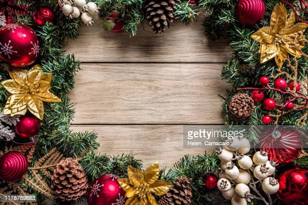 christmas garland and decoration making a frame with copy space - christmas frame stock pictures, royalty-free photos & images