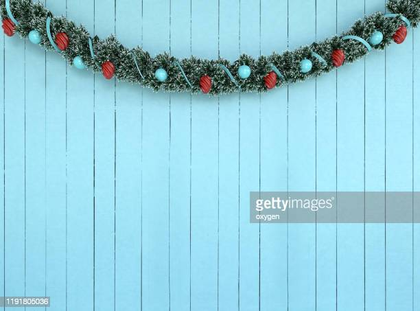 christmas garland decorationon on aqua wooden wall background, 3d rendering - garland stock pictures, royalty-free photos & images
