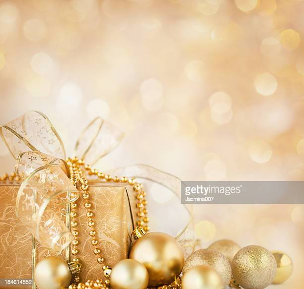 Christmas gift and  gold baubles