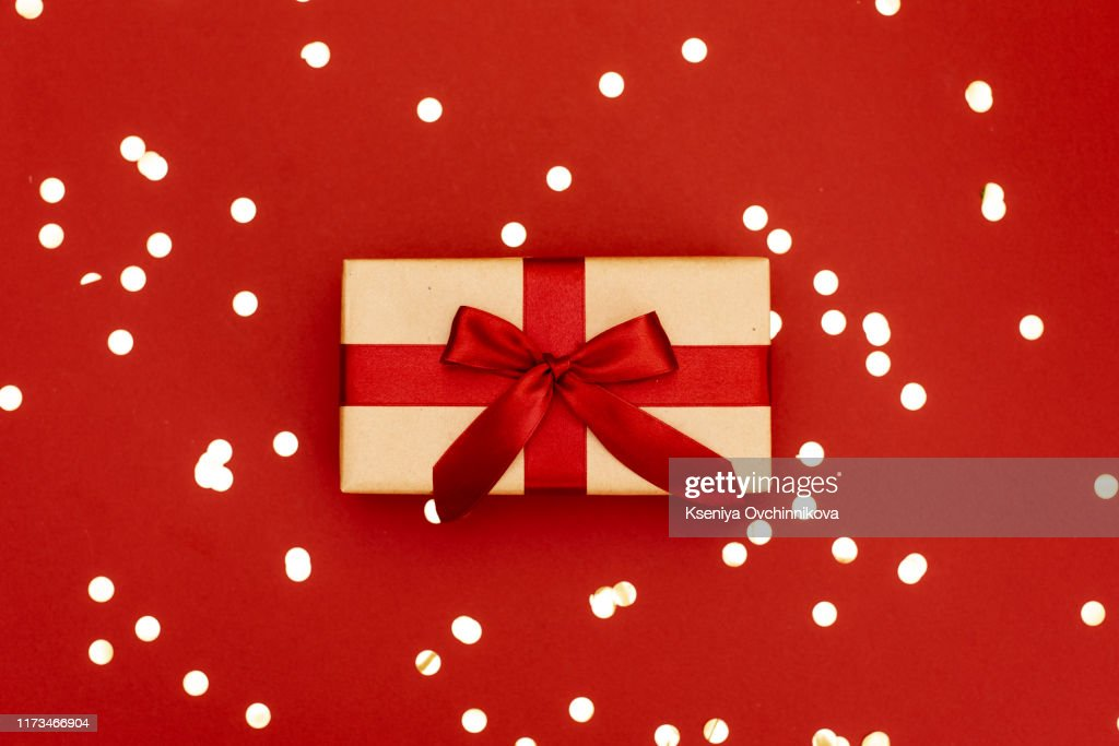 Christmas gift box against turquoise bokeh background. Holiday greeting card. : Stock Photo
