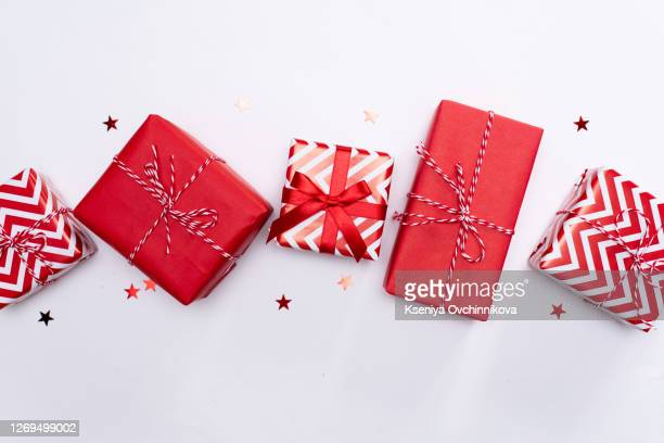 christmas gift boxes on white background - holiday stock pictures, royalty-free photos & images
