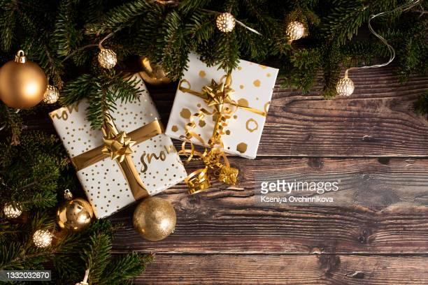 christmas gift boxes with decorations - kieferngewächse stock-fotos und bilder