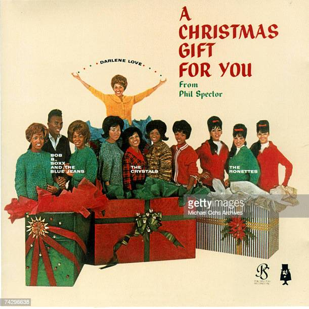 "Christmas Gift For You"" from Phil Spector album cover featuring Bobb B. Soxx and The Blue Jeans, Darlene Love, The Crystals, and The Ronettes which..."