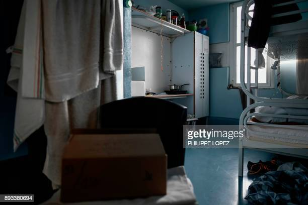 A Christmas gift left by the Christian charity organization 'Secours Catholique' is seen on a chair in a cell as part of a distribution of Christmas...