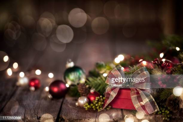 christmas gift on old wood background - country christmas stock pictures, royalty-free photos & images