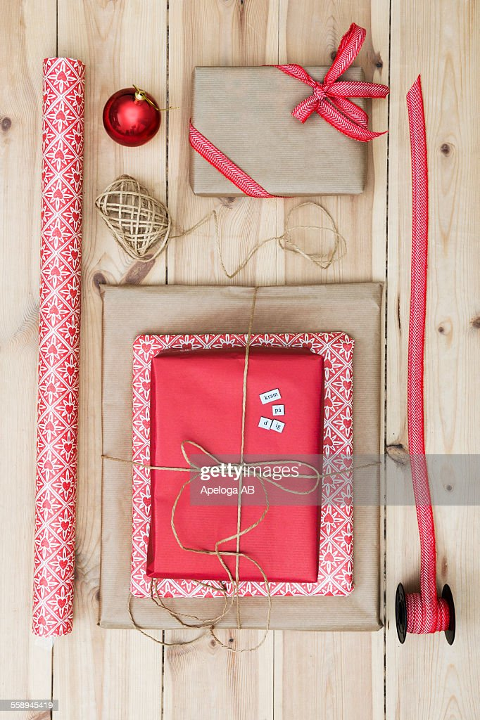 Christmas Gift Packages.Christmas Gift Packages On Wooden Floor High Res Stock Photo